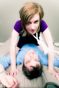 Couple in bed demonstrating the bondage of addiction requiring Sex Therapist Calgary to treat.