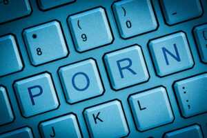 Image of a keyboard showing the word porn that we treat through sex addiction Calgary